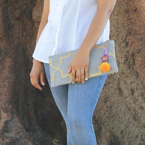 Model with Bohemian clutch in Grey