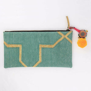 Mint colored bohemian dhurrie clutch