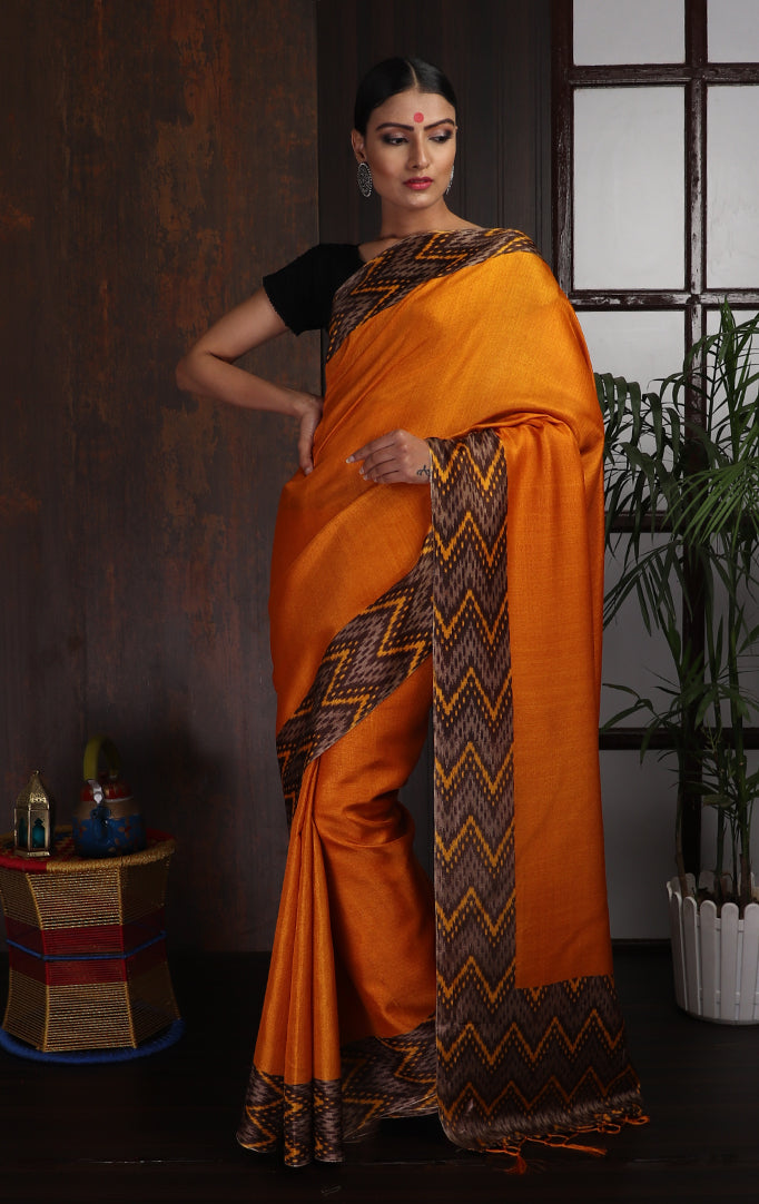 Bright Orange Saree with Black Chevron Border