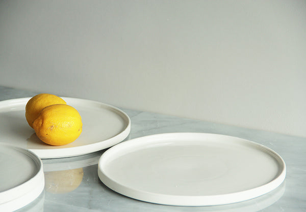 Dinner plate with rim. White porcelain. Dishwasher safe.