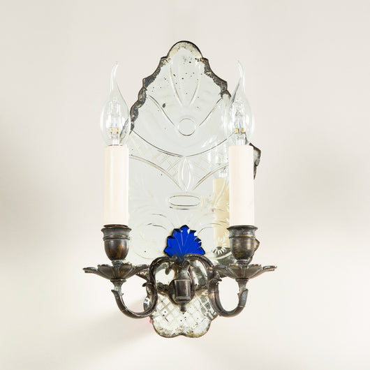 A pair of early 19th century wall sconces with shaped mirrored back plates with cut-glass decoration and blue glass details. Rewired.