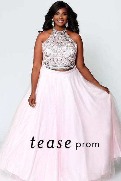 TE1943 plus size two-piece prom dress in doll pink or ice blue; heavily beaded halter bodice with key-hole cut out back; tulle a-line skirt
