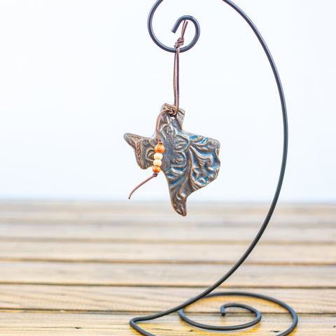 Blue Texas Ornament with a Bronze Floral Design