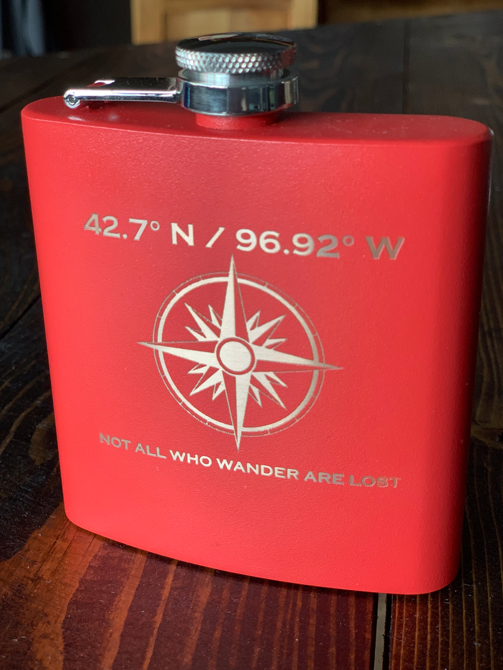 Red engraved flask with Vermillion coordinates