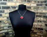 heart necklace on mannequin