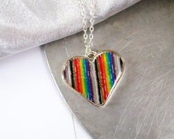 rainbow ribbon cable made into a heart necklace with resin