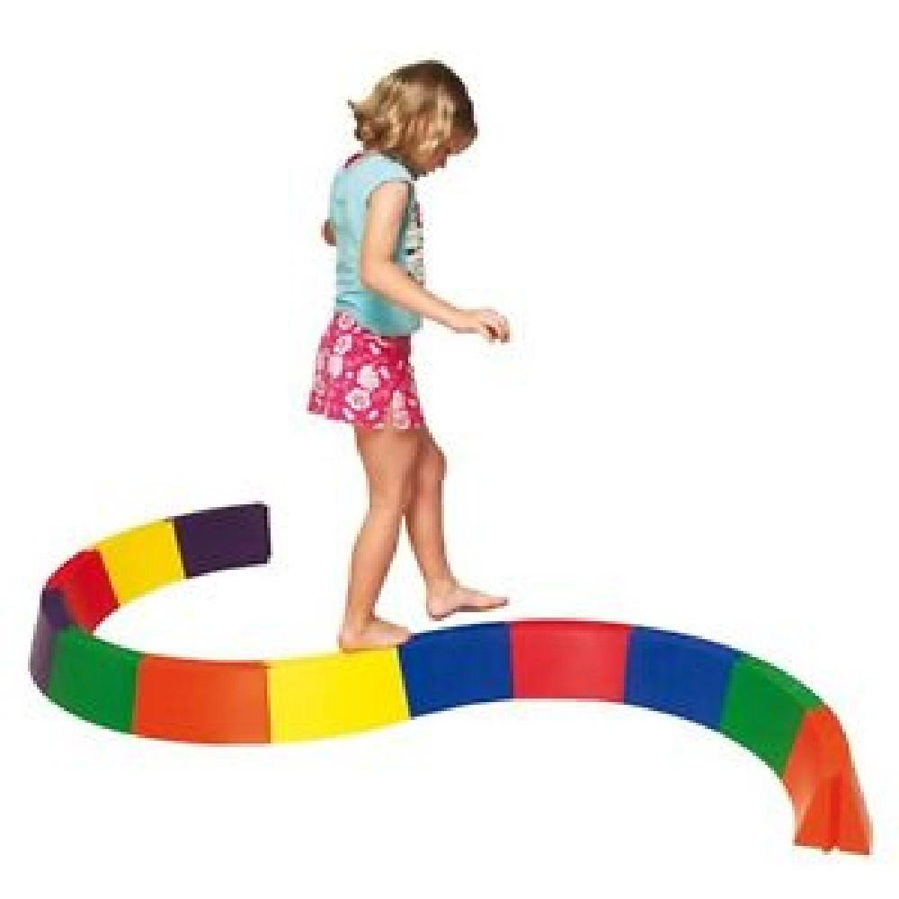 young girl walking on rainbow balance beam