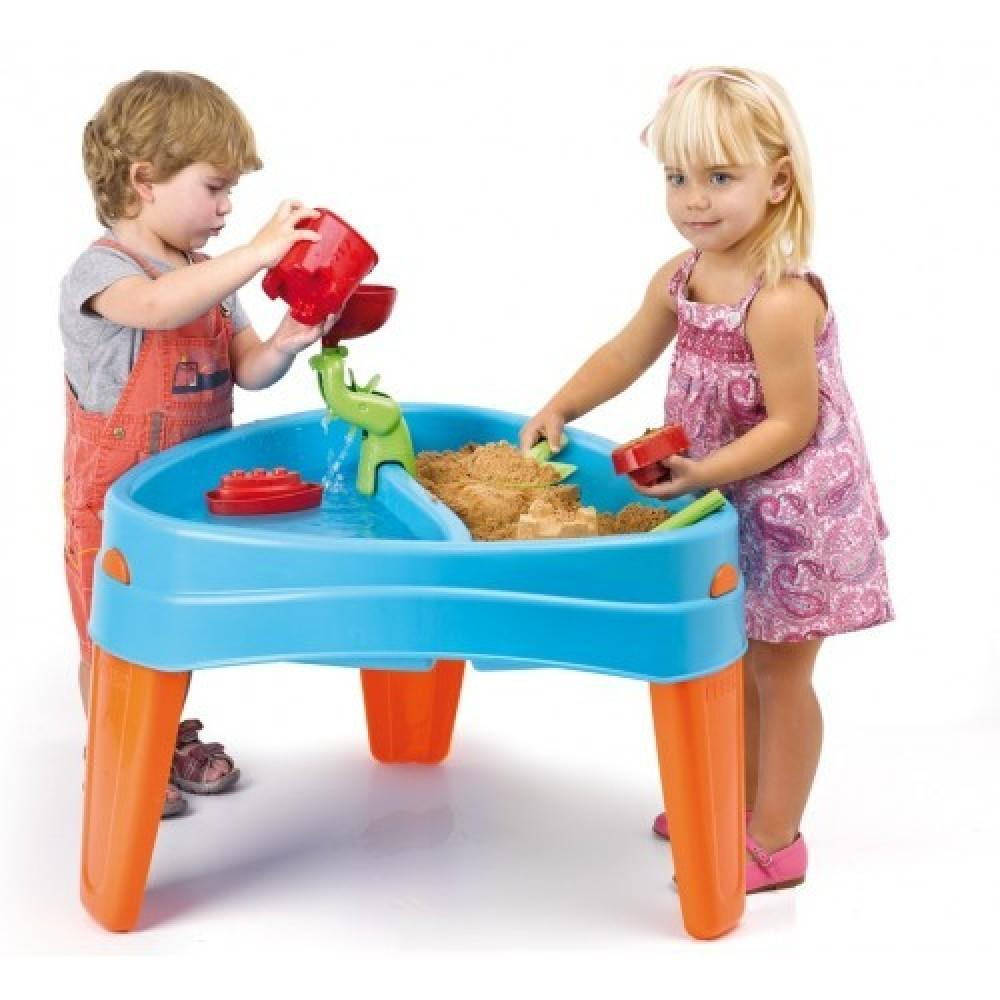 young boy and girl playing with sand and water toy