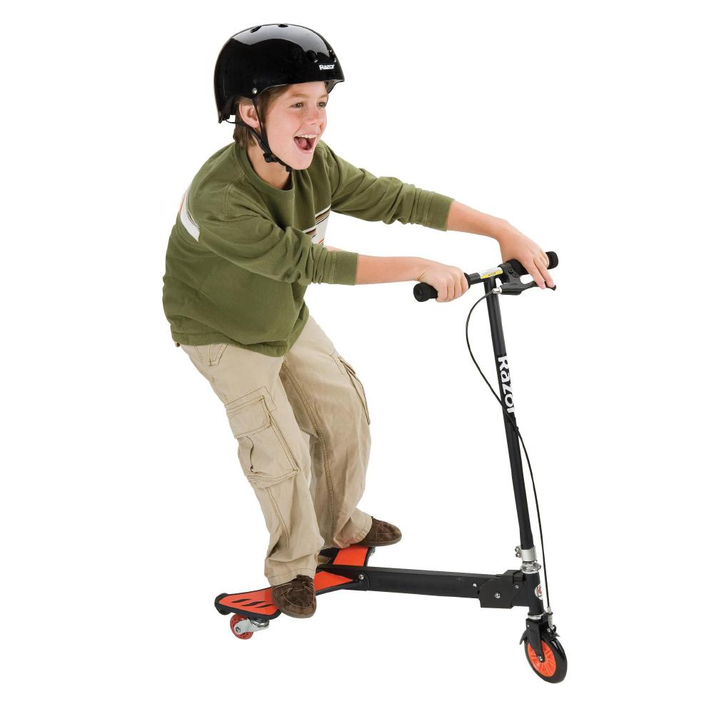 boy with black helmet riding a razor wing scooter