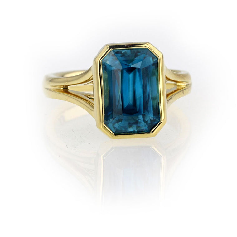 Blue Zircon set in 18K yellow Gold