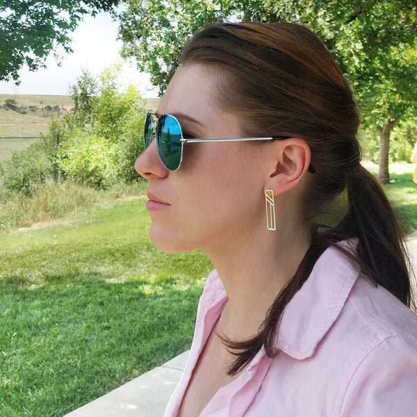 Silver Flying Buttress Earrings on a model. Travel and architecture inspired jewelry by Tinker Company.