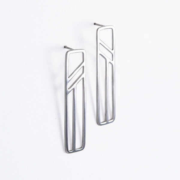 Silver Flying Buttress Earrings, a pair of silver geometric earrings from a collection of abstract architectural jewelry by Tinker Company. Sustainable made in NYC.