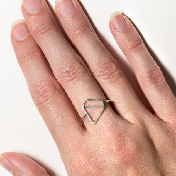Ice Diamond Ring - Sterling silver ring in the shape of a faceted gemstone designed by Tinker Company. Shown here on model.