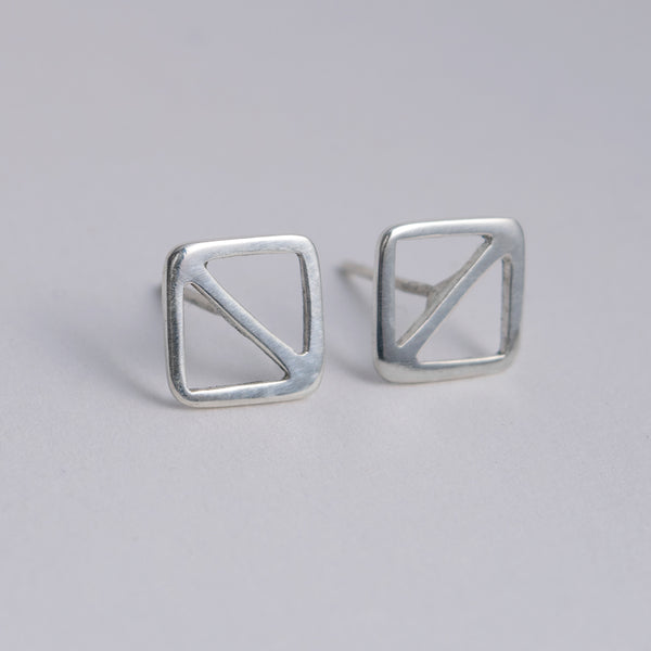 A facing pair of geometric nautical earrings in a square shape with a diagonal line, shown here with centered posts.