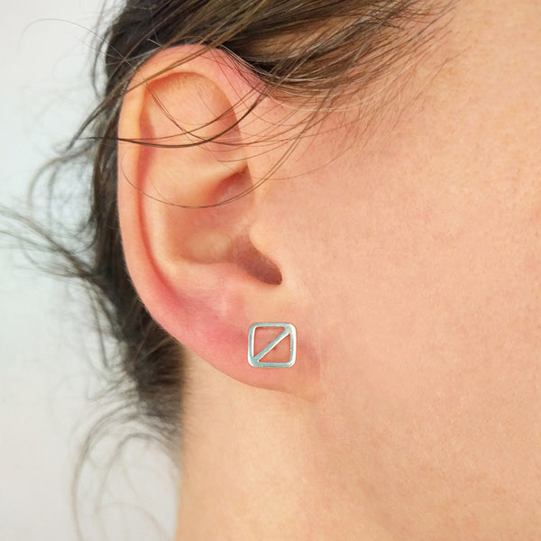 Overboard Flag Stud Earrings in sterling silver, shown on model.