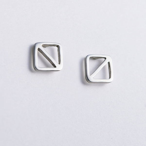 Overboard Flag Stud Earrings in sterling silver, shown here with posts positioned on the top edge.