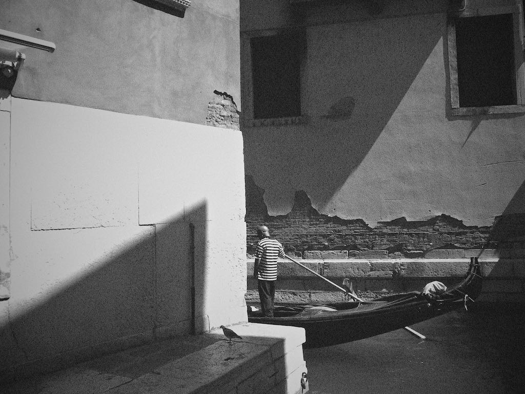 Gondolier 2/6, Venice Italy - Travel wall art prints by Edwin Datoc Gallery