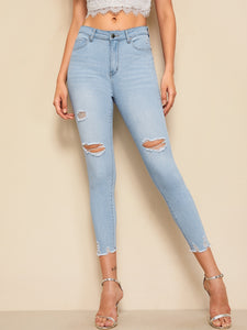 Ripped Raw Hem Faded Wash Jeggings
