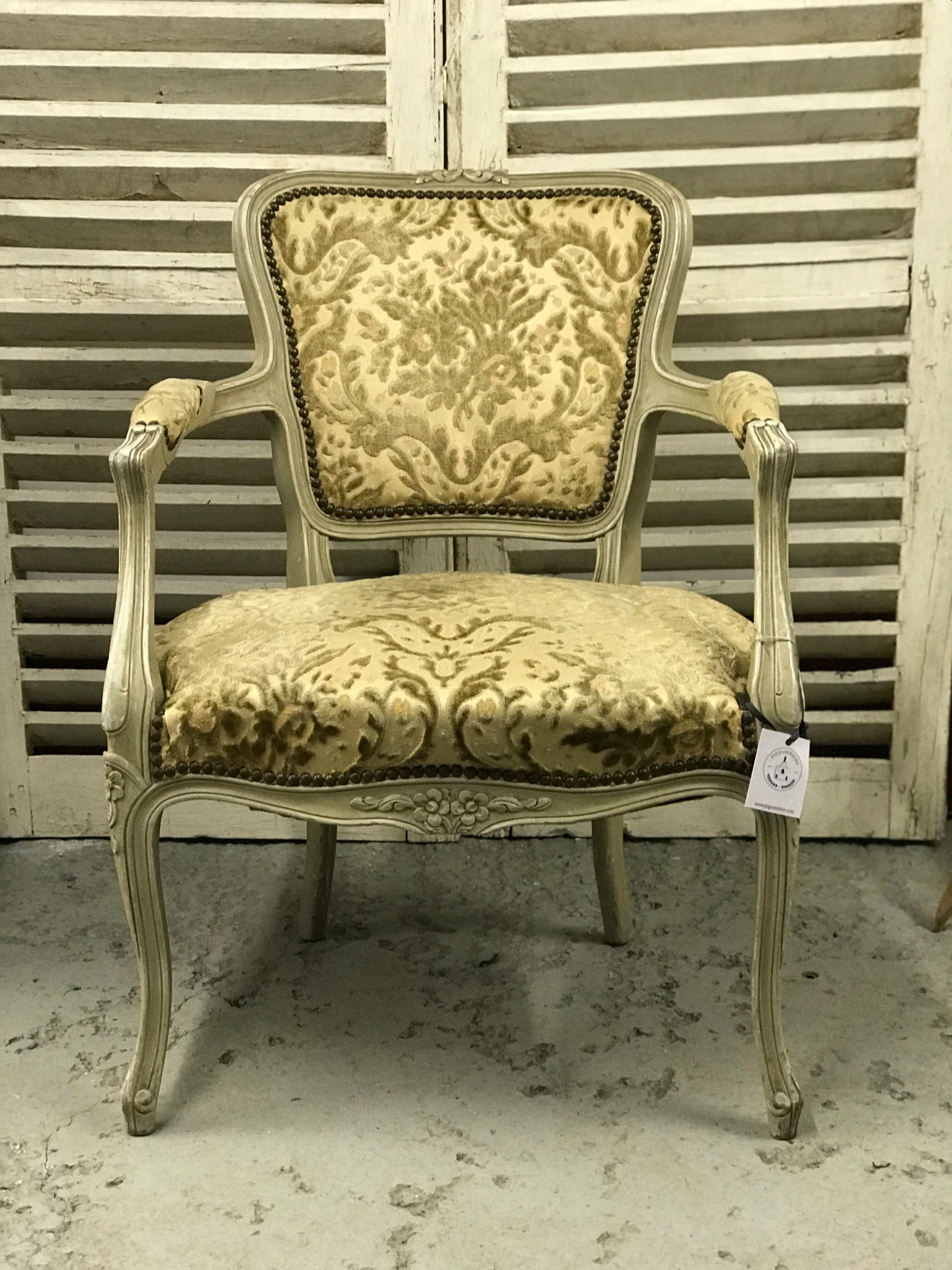 Early 20th century French salon chair with original upholstery.