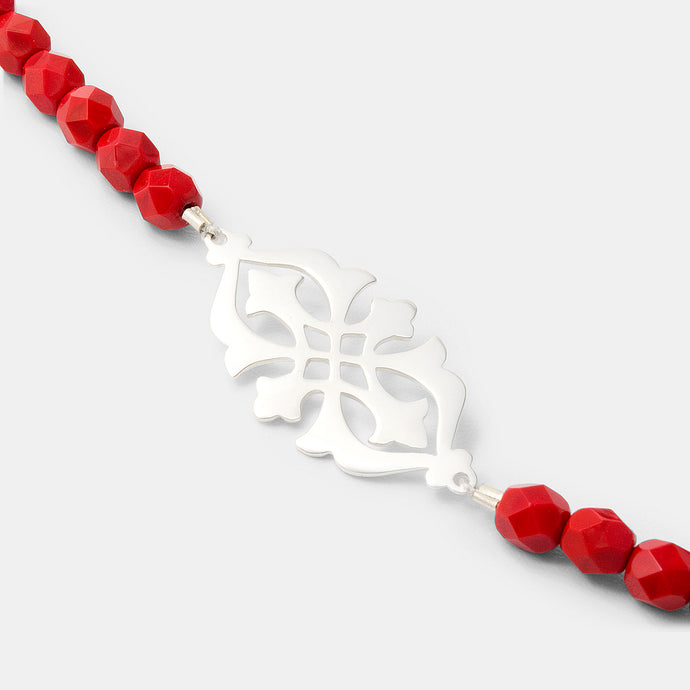Arabesque pendant on red bead necklace: handmade statement jewelry design in our online jewelry store.