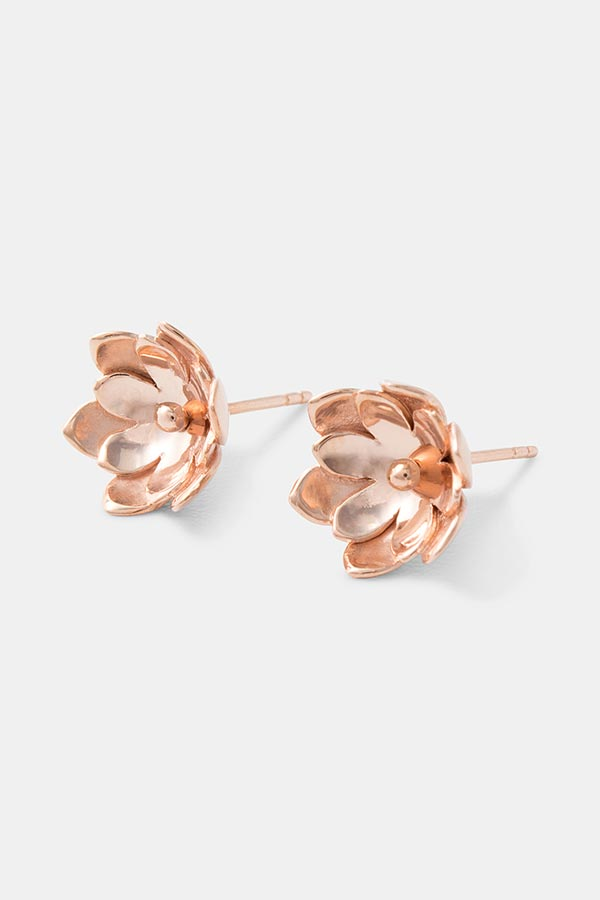 Beautiful rose gold stud earrings: double tulip flower earrings which will stand out from the crowd. Handmade designer jewelry online.