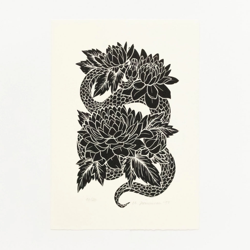 Old-school tattoo flash style linocut art print of a black snake and dahlia flowers in full bloom on white A4 paper.