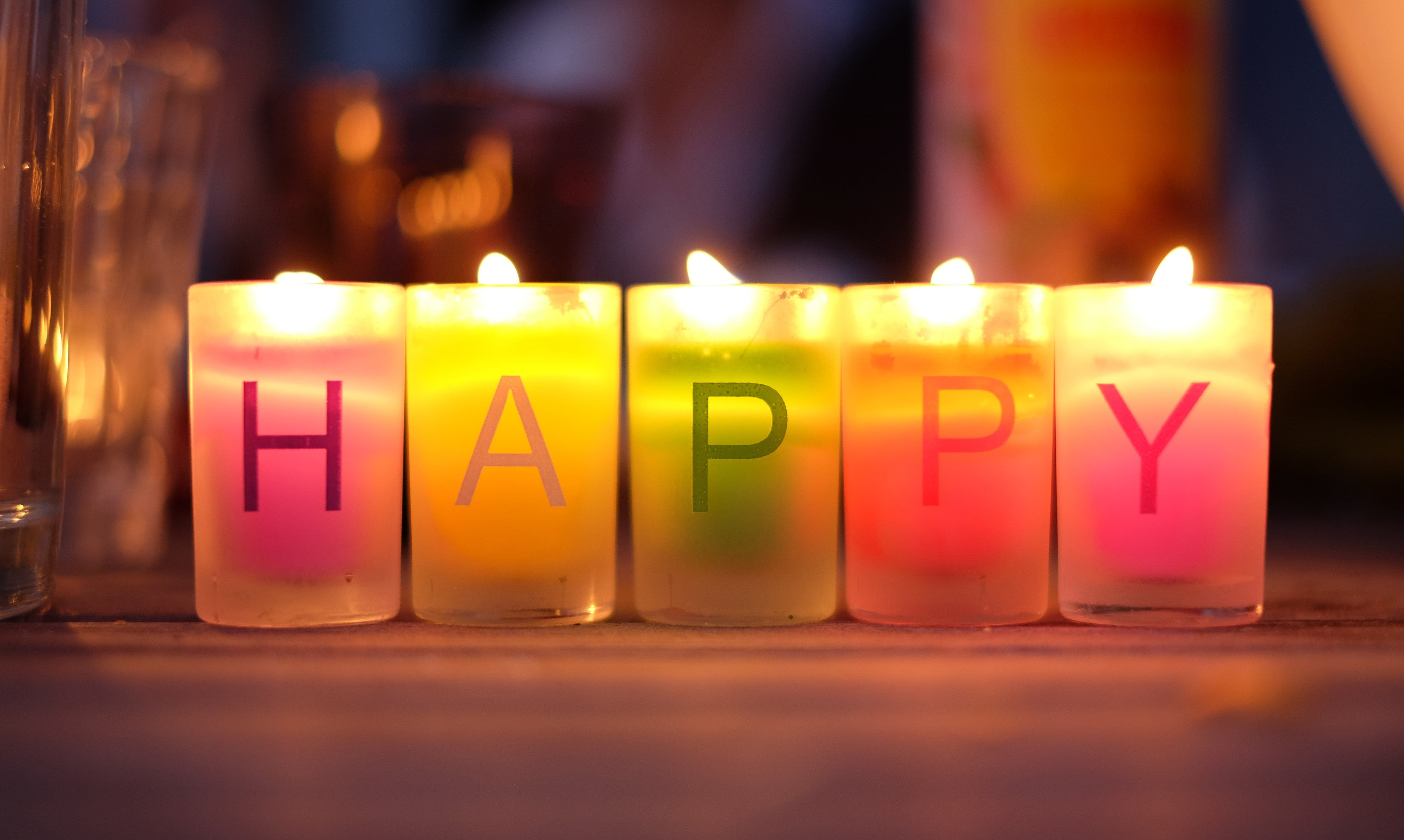 Candles that spell happy