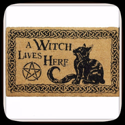 a witch lives here doormat outdoor decor