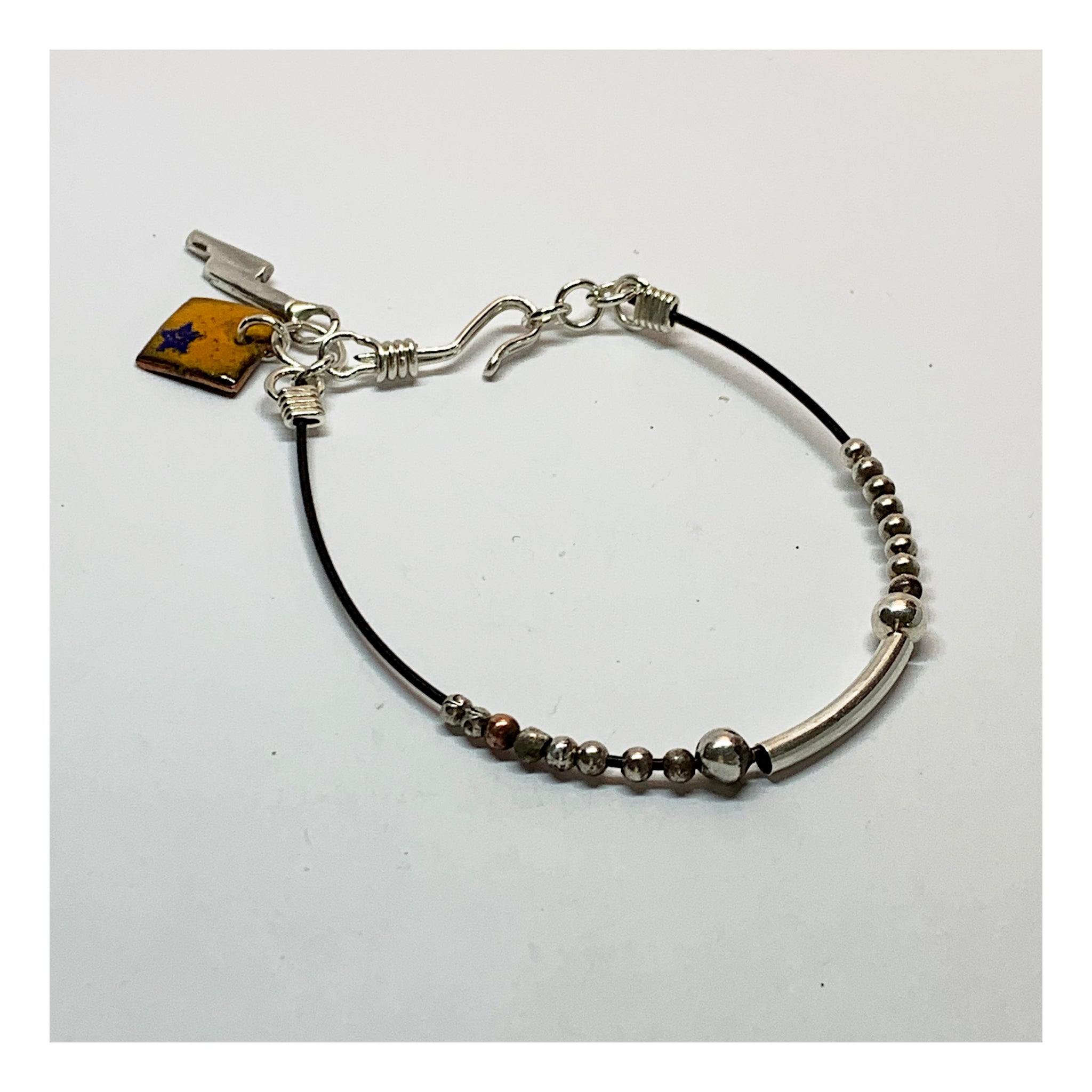 Unusual Silver bead Bracelet with Random Charms