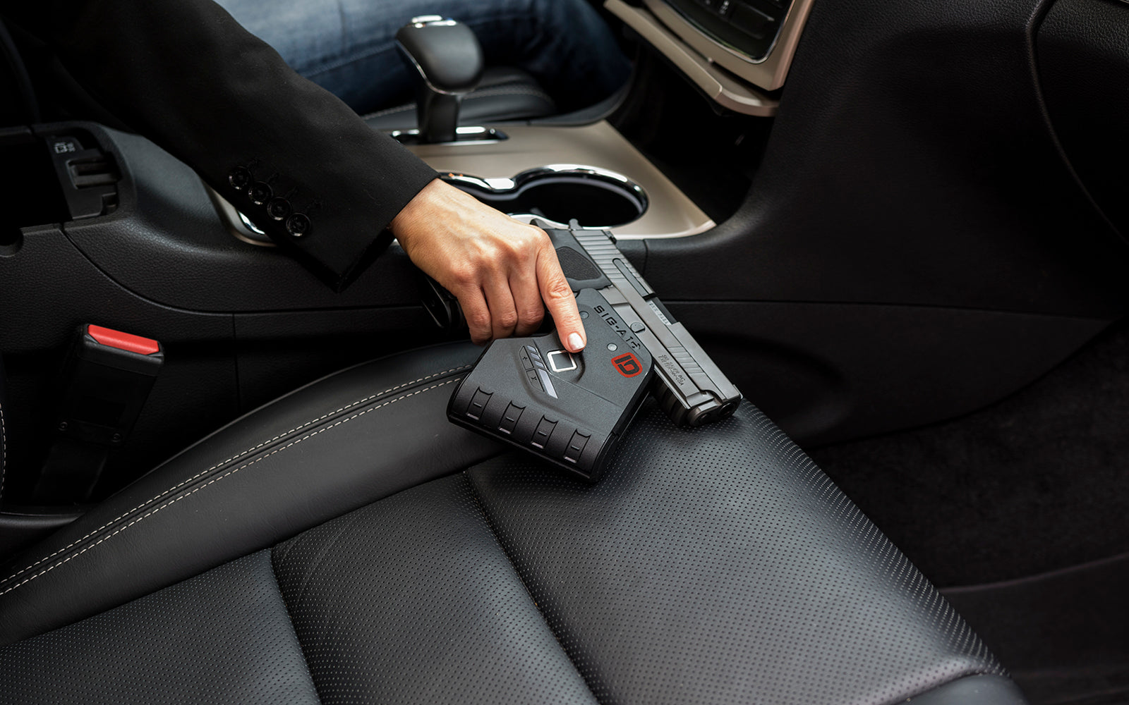 Woman holding IDENTILOCK–Biometric Fingerprint gun lock in car