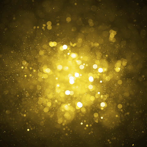 Gold sparkles on a black background
