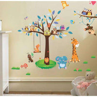 Playing animals on the swing under the tree wall sticker