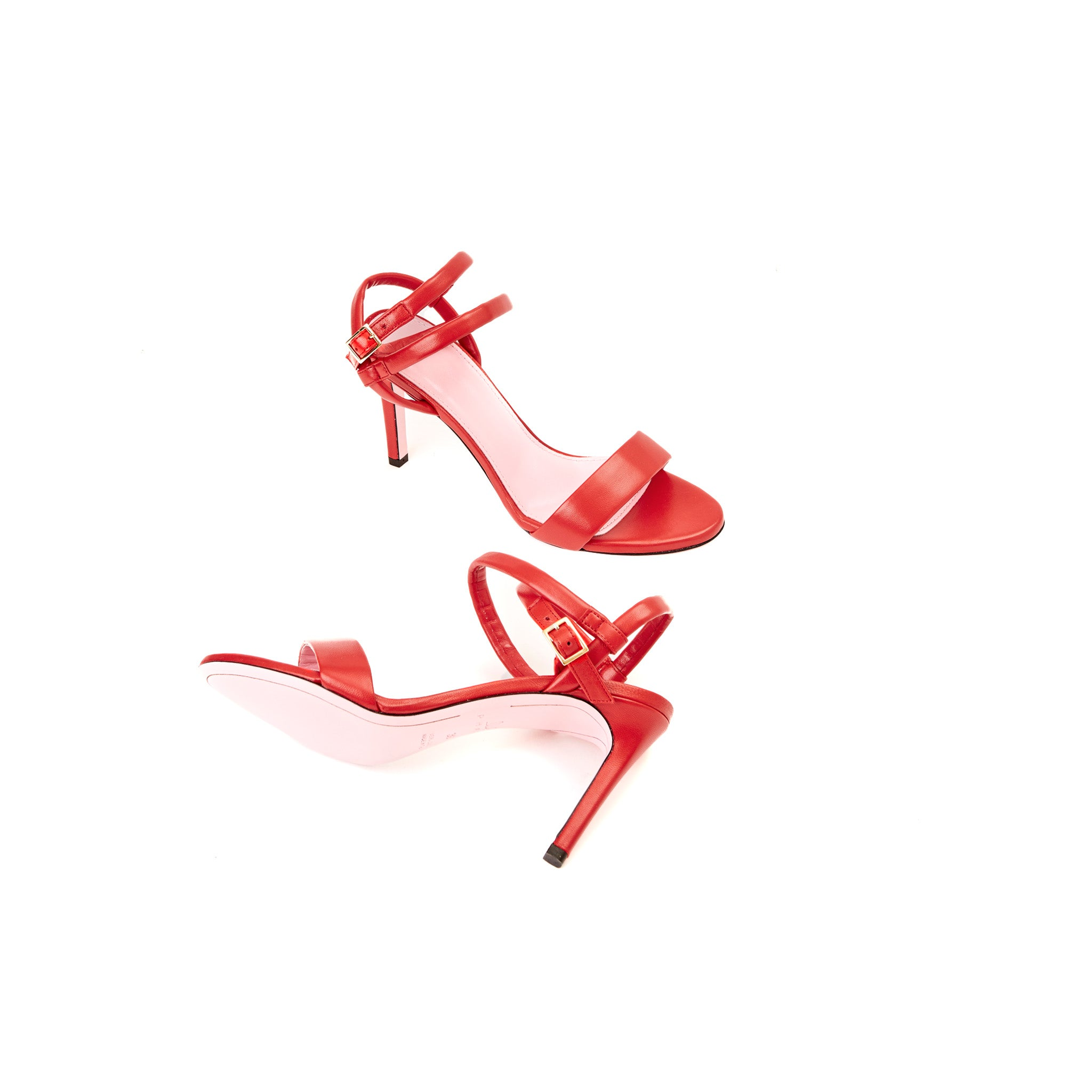 Phare Wrap ankle strap high heel sandal in red leather sole view