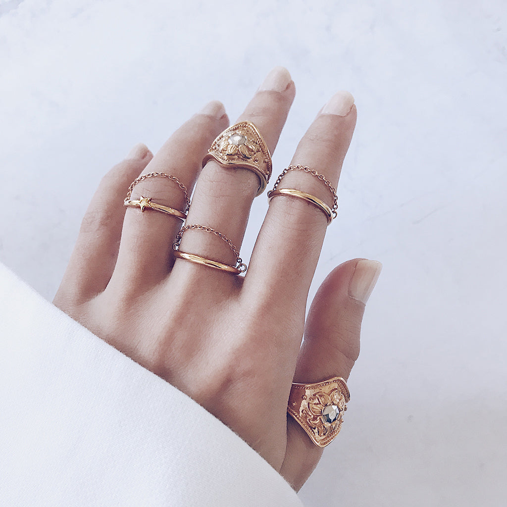 beautiful gold stacking rings in fine and chunky ring designs - mix and match gold chunky rings and fine stacking rings to create your own unique ring stack idea. great for re-using old rings that you have. womens ring stacking trend.