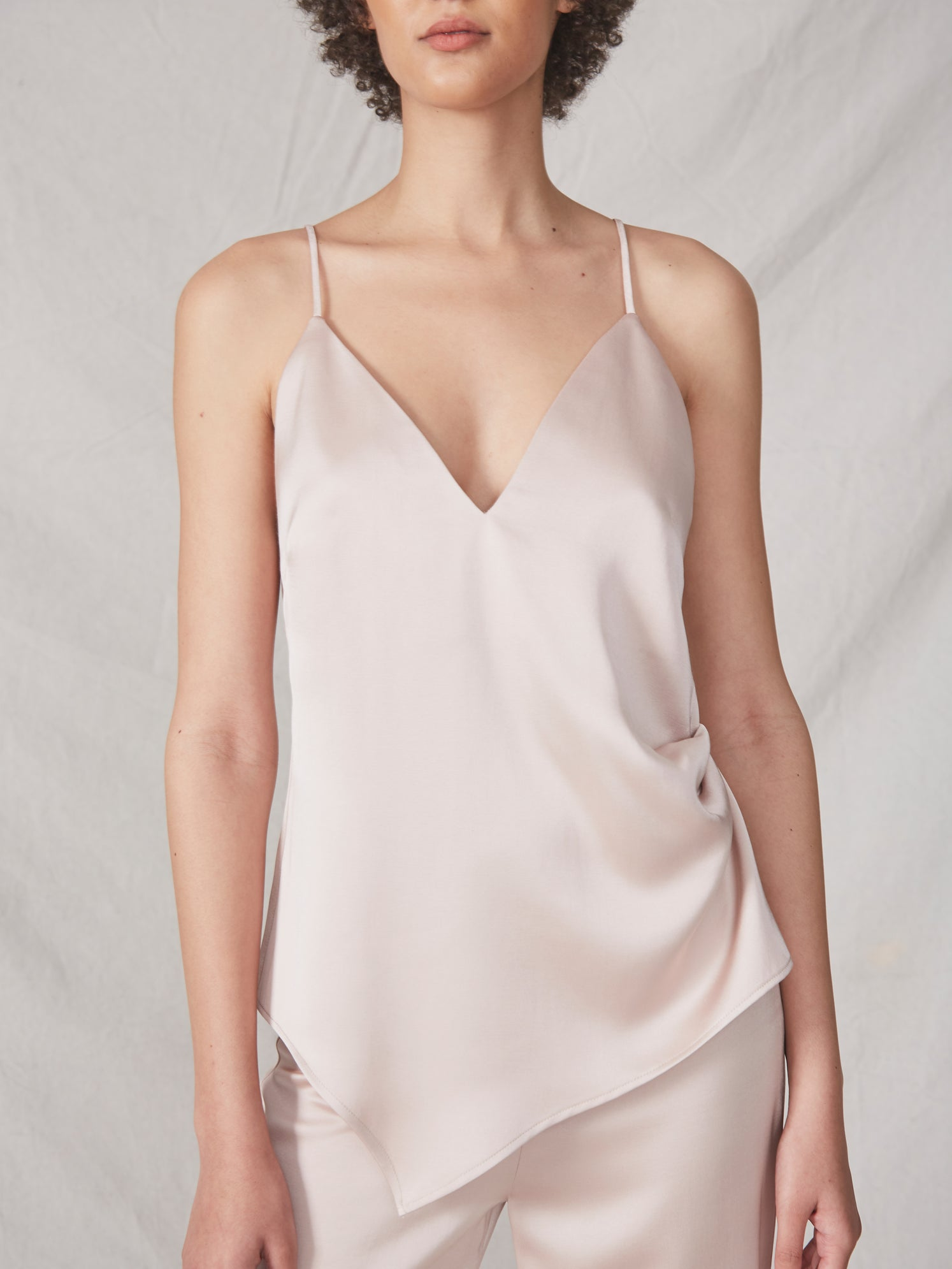 Deep v asymmetrical hem side ruched adjustable strap matte satin top