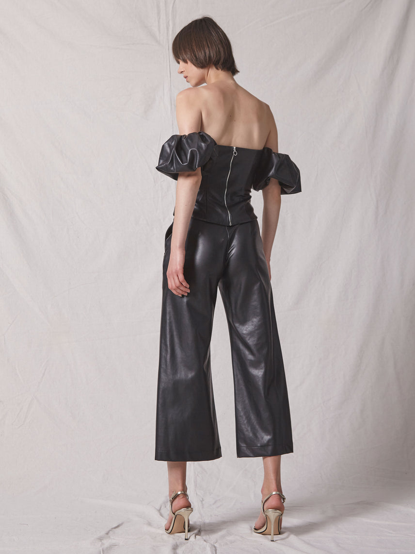 Cropped vegan leather pant with bottom flare and matching off shoulder top Alternate