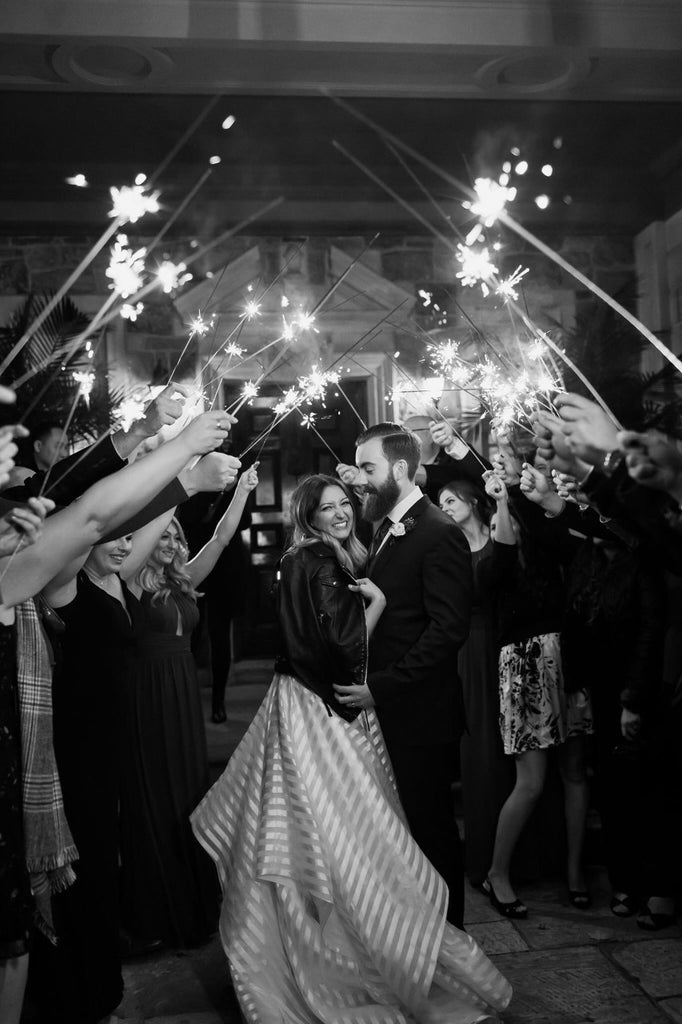 A wedding featuring fireworks and a romantic setting.