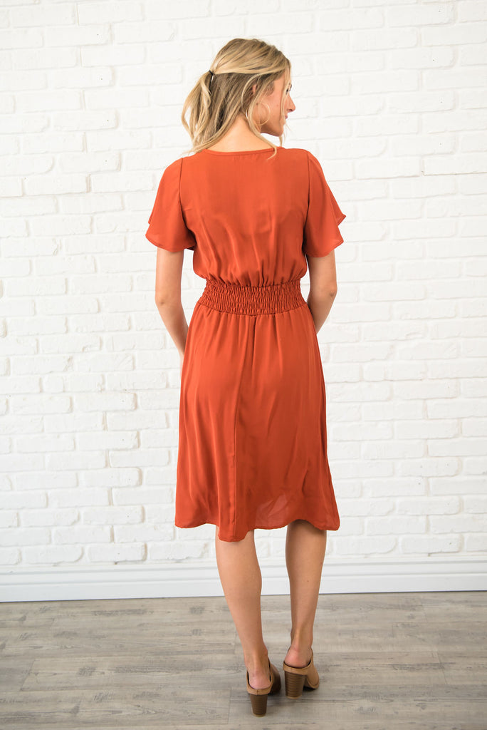 CAMMIE MIDI DRESS IN RUST WITH SMOCKING AT THE WAIST
