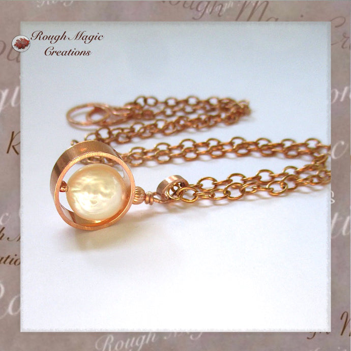 Copper and white freshwater pearl drop pendant on adjustable copper chain, goes from choker up to 19 inch princess length.