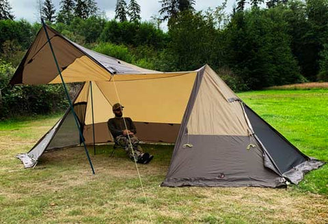 Twinpeak Tent Awning Open with Chair and Hunter