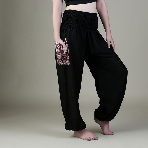 Model wearing Christy black pants with elephant pocket from front