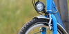 Close up of front bike light on blue bicycle
