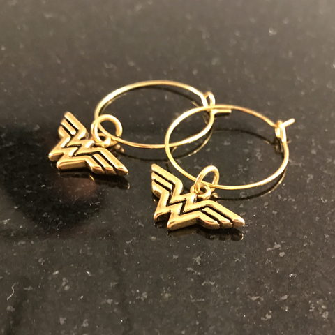 """Wonder Woman"" gold hoop earrings"