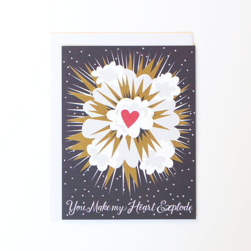 An explosion with gold ink and a message of love: you make my heart explode.
