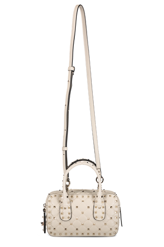 Front image with strap detail of Valentino Rockstud Spike Small Duffle Bag Light Ivory