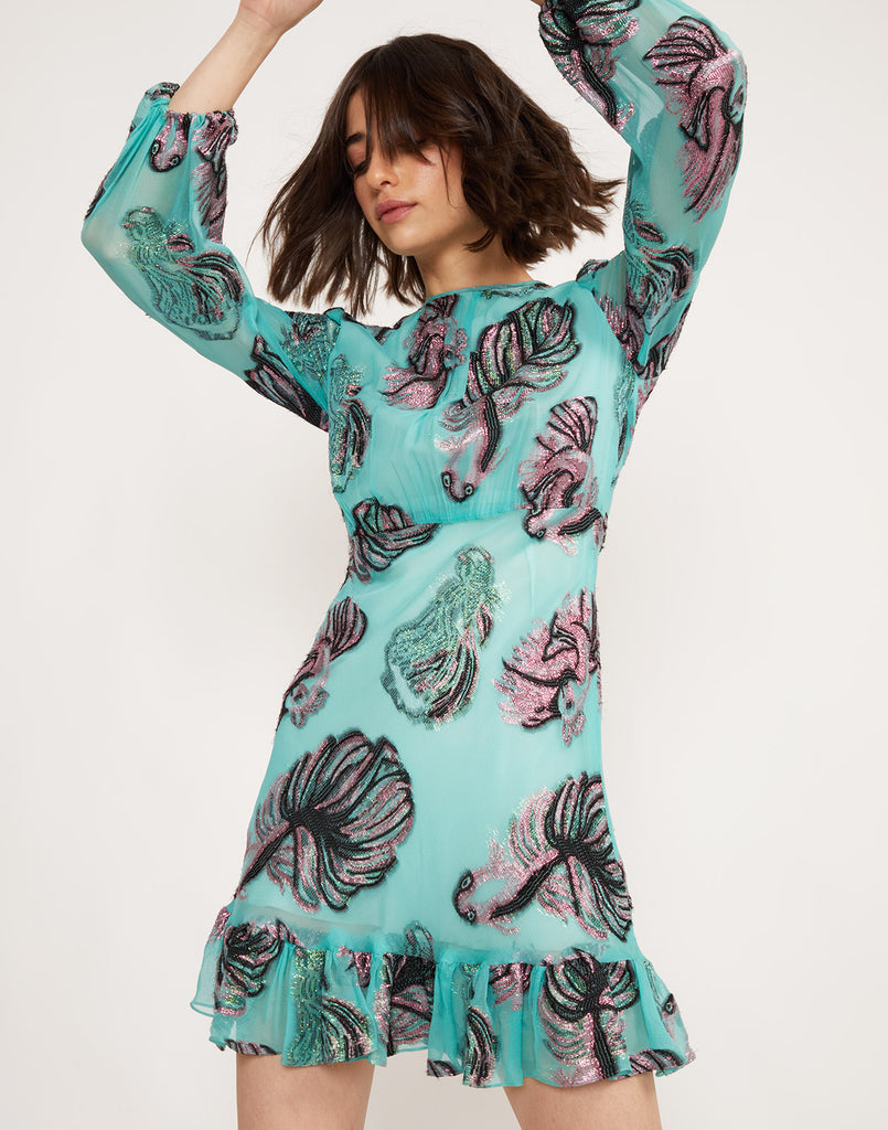 Close view of the Inverness metallic fish dress in lightweight teal chiffon.