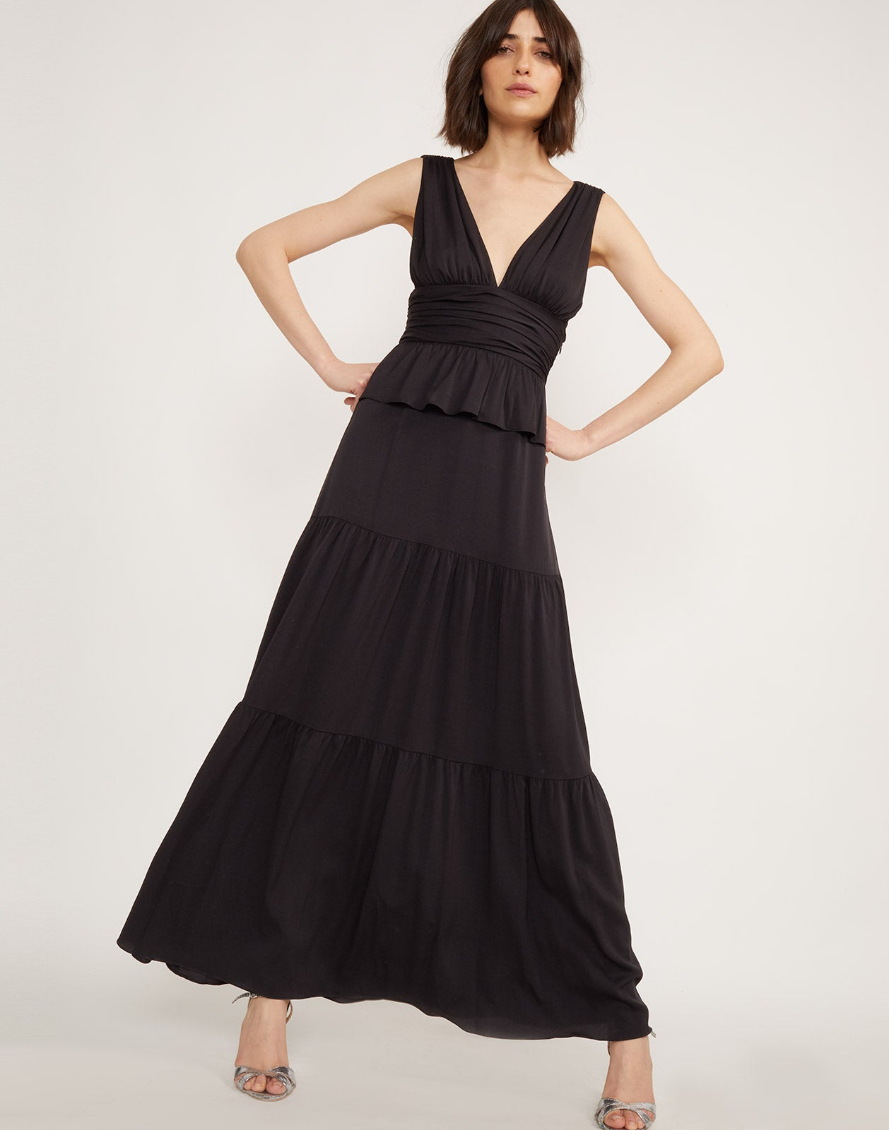 Full view of model wearing Zadie tiered maxi dress in black.