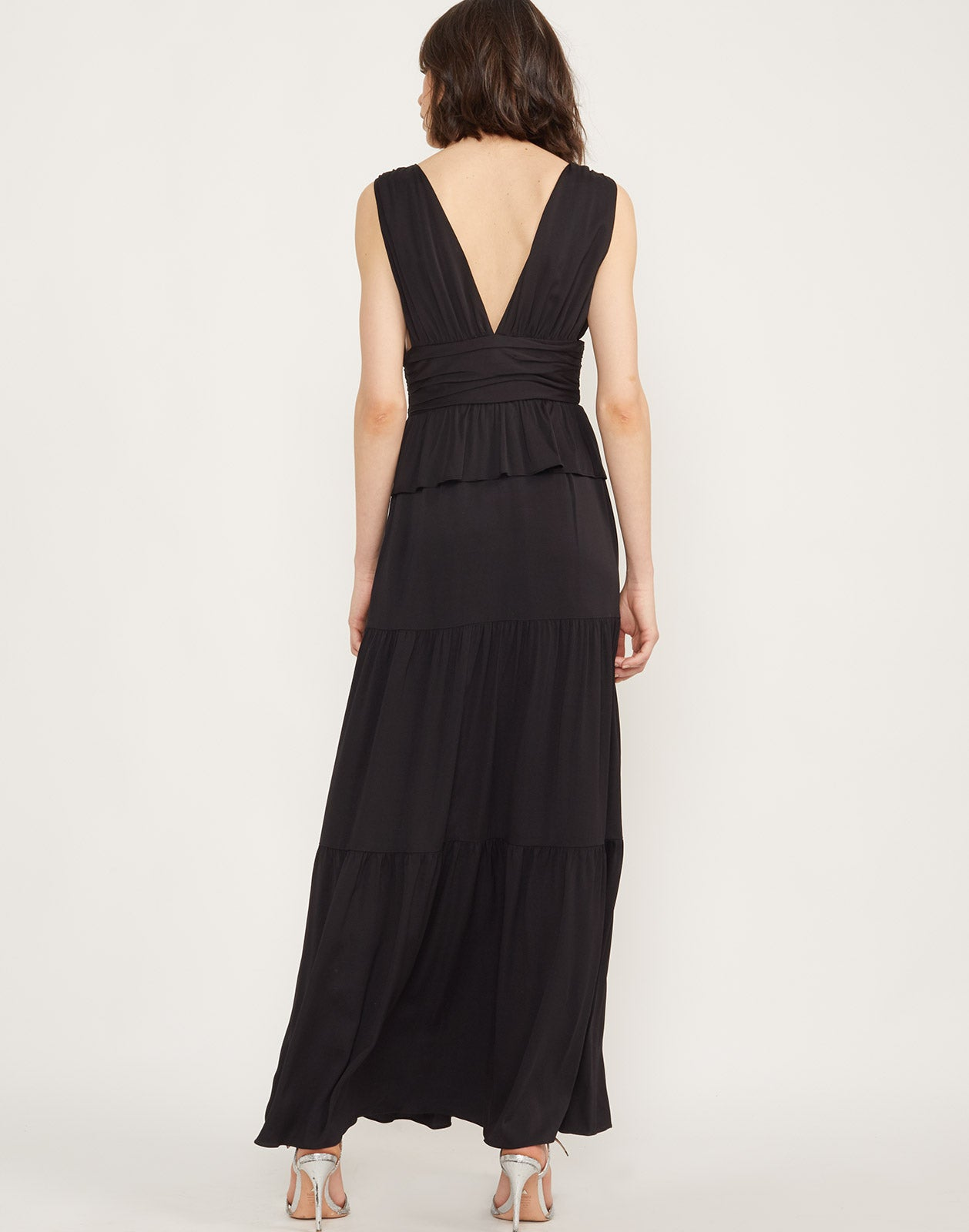 Full back view of model wearing Zadie tiered maxi dress in black.