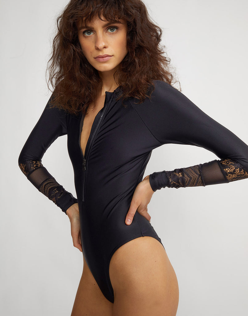 Angled front view of the one piece Lace Hepburn Surfsuit with mesh