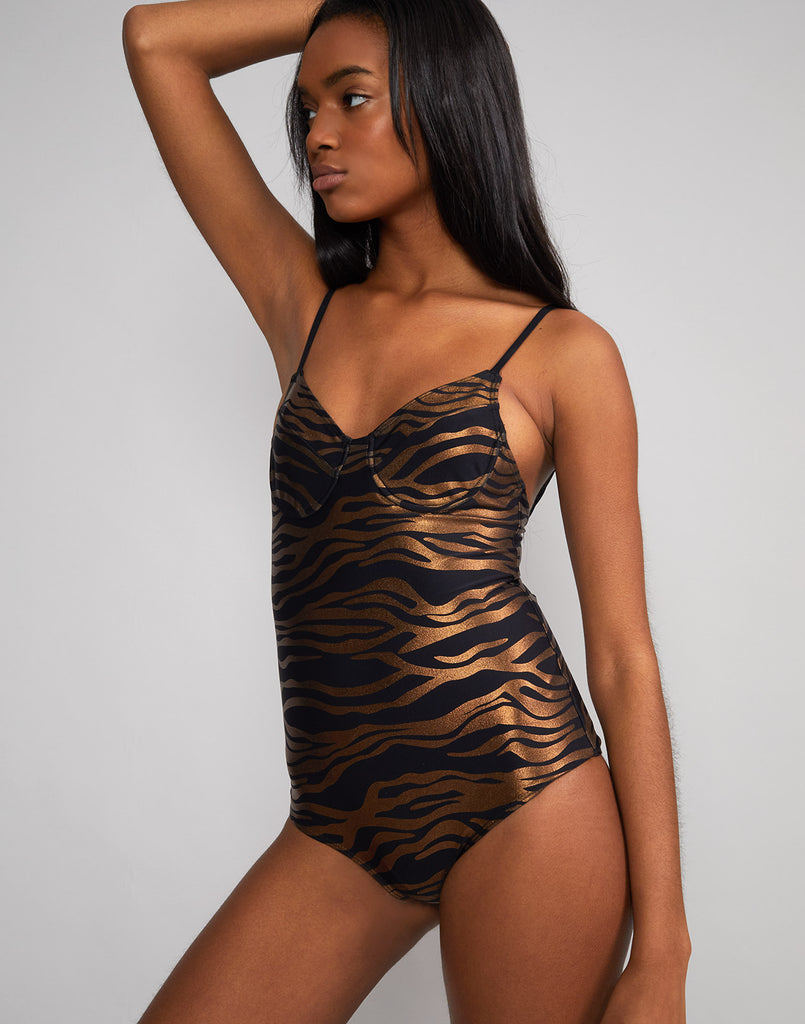Angled front view of zebra sandi swimsuit